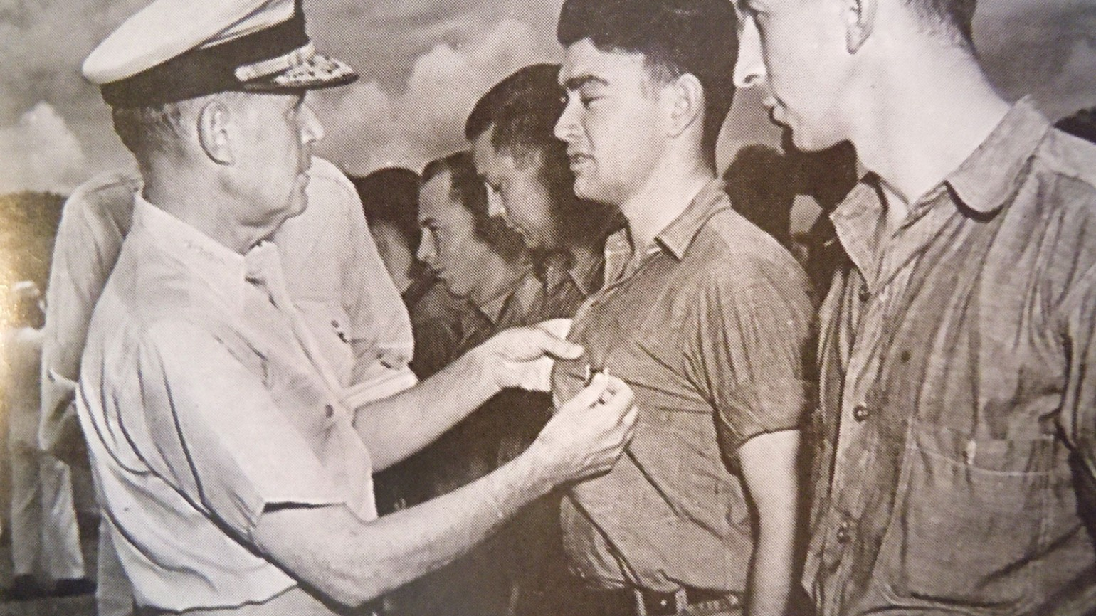 Admiral Spruance presenting the surviving crew members with the Purple Heart. Photo courtesy of Alfred J. Sedivi Collection - USNI.