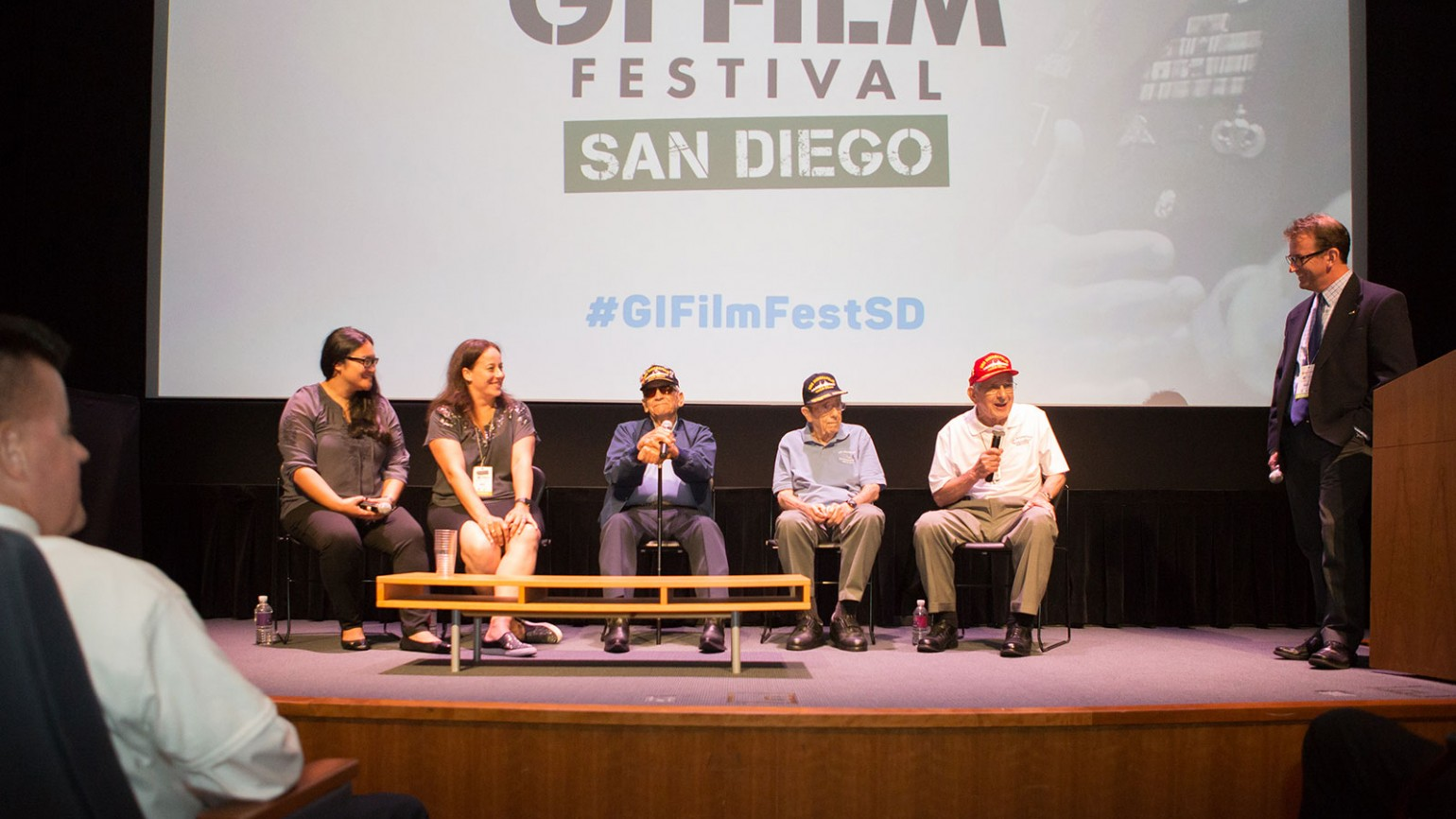 "Panelists at the GI Film Festival San Diego Opening Night screening of ""USS Indianapolis: The Legacy."" From left to right: Melanie Capacia Johnson, Sara Vladic, Al Celaya (USS Indy Survivor), John Woolston (USS Indy Survivor), and Edgar Harrell (USS Indy Survivor), and panel moderator John Decker."
