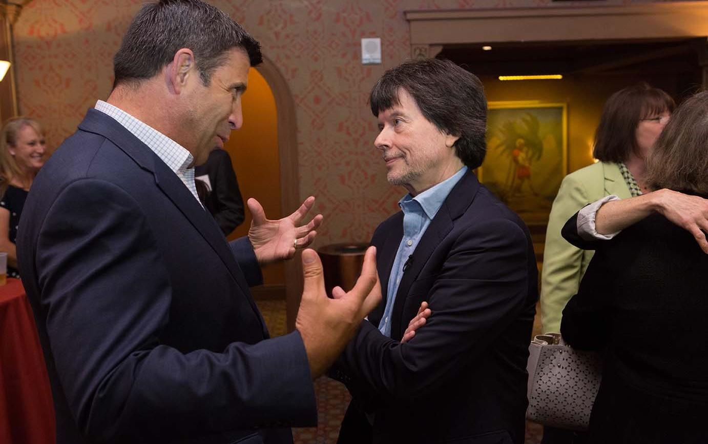 Filmmaker Ken Burns in conversation with attendee.