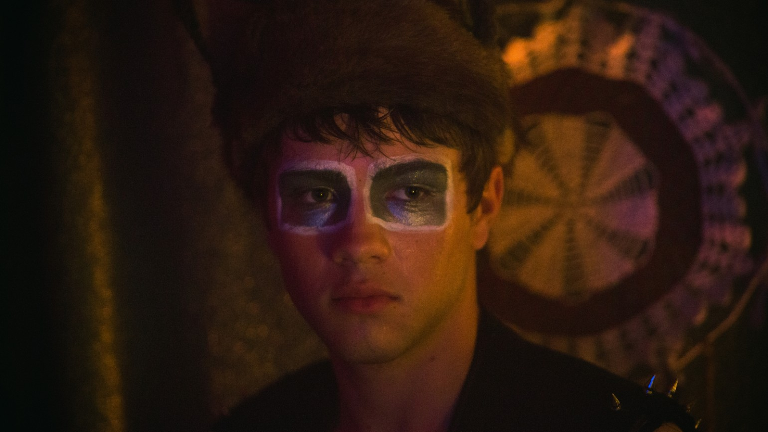Oscar (Connor Jessup) in costume at Wilder's house party.