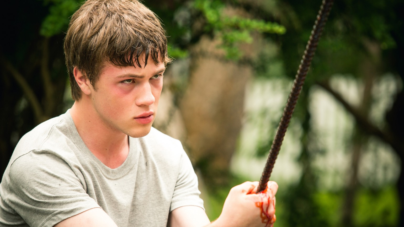 Oscar (Connor Jessup) holding a bloody piece of rebar.