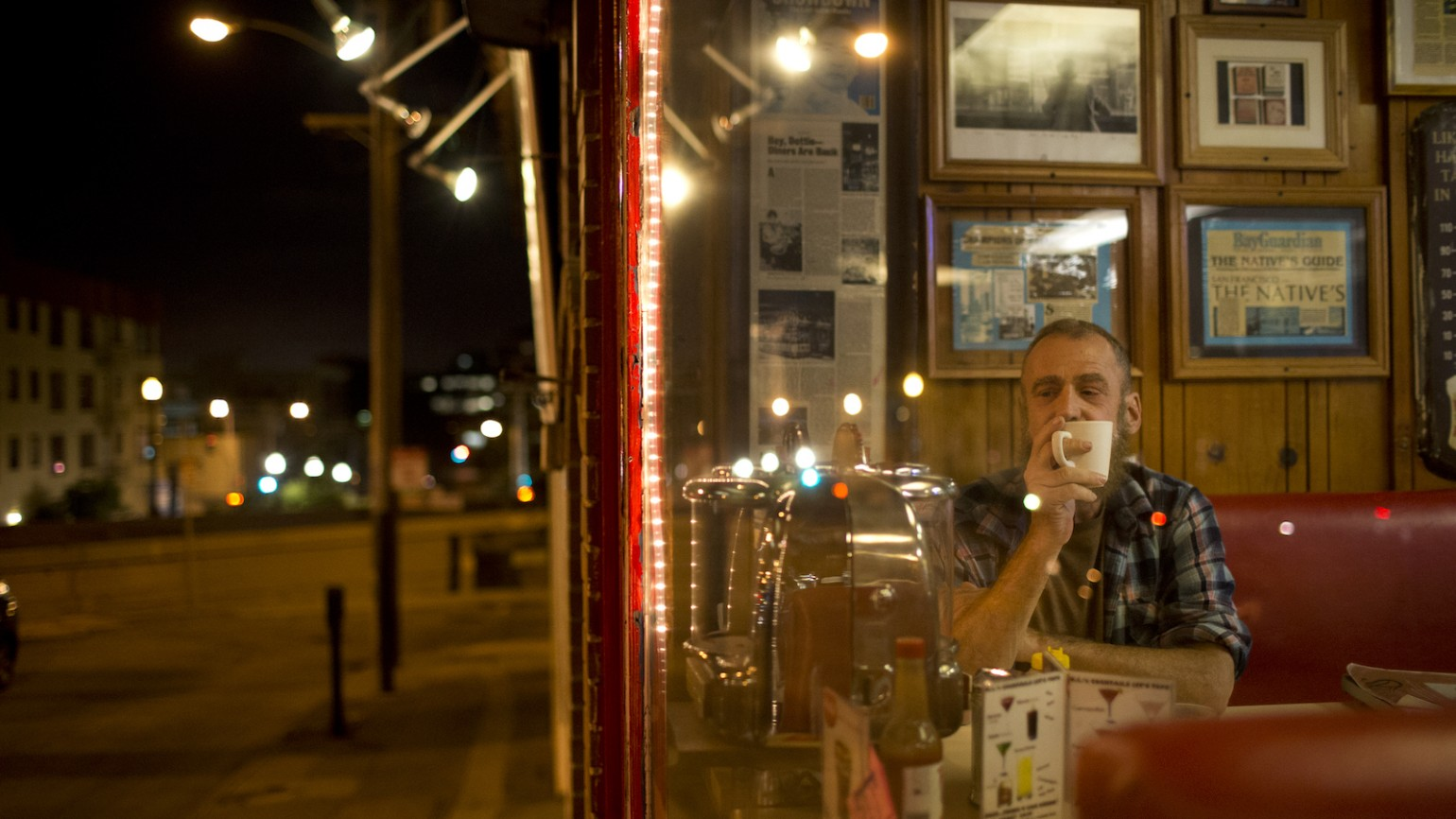 Peter Greene has a cup of coffee and pancakes at It's Tops Coffee Shop on Market Street following a night of singing songs accompanied by friends on the piano at Martuni's on in San Francisco, Calif. on Tuesday, September 22, 2015. (Photo by Tim Hussin)