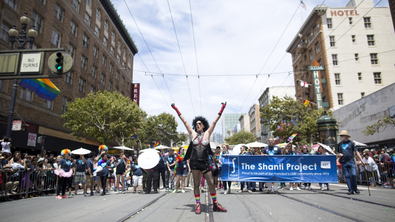 Harry Breaux, 70, a long-term AIDS survivor, runs through the2015 San Francisco Pride Celebration & Parade dressed as Dr. Frank-N-Furter from Rocky Horror Picture Show on June 25, 2015 in San Francisco, Calif. Breaux had dressed as the character for the parade 25 years prior and was recreating the costume in honor of The Shanti Project and long-term AIDS survivors.  (Photo by Tim Hussin)