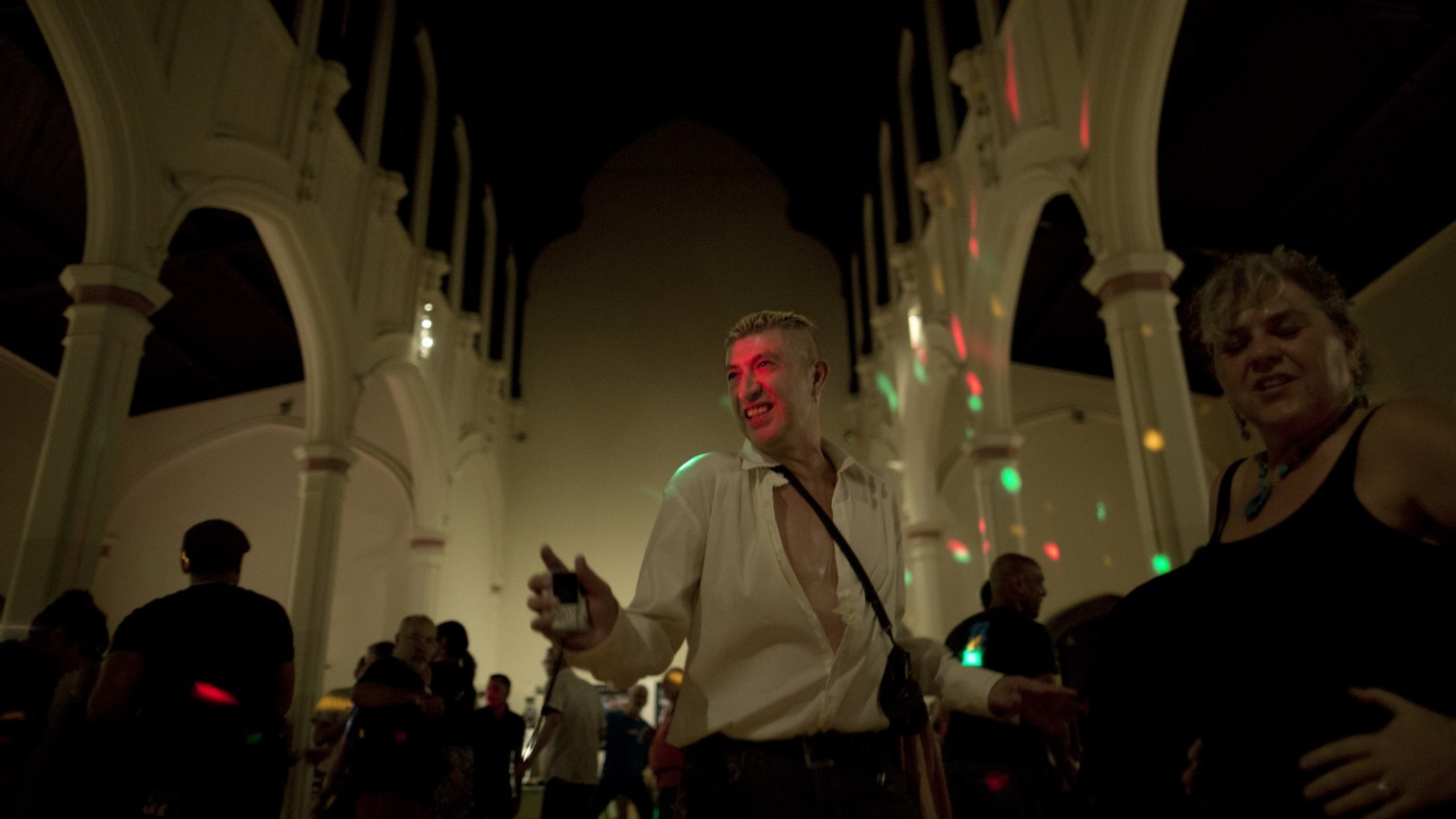 """Jesus Guillen, a long-term AIDS survivor, dances during Shanti's Honoring Our Experience """"Revival! 2,"""" a community-building dance event hosted by long-term AIDS survivors, at the Episcopal Church of Saint John the Evangelist in San Francisco on Friday, October 2, 2015. (Photo by Tim Hussin)"""