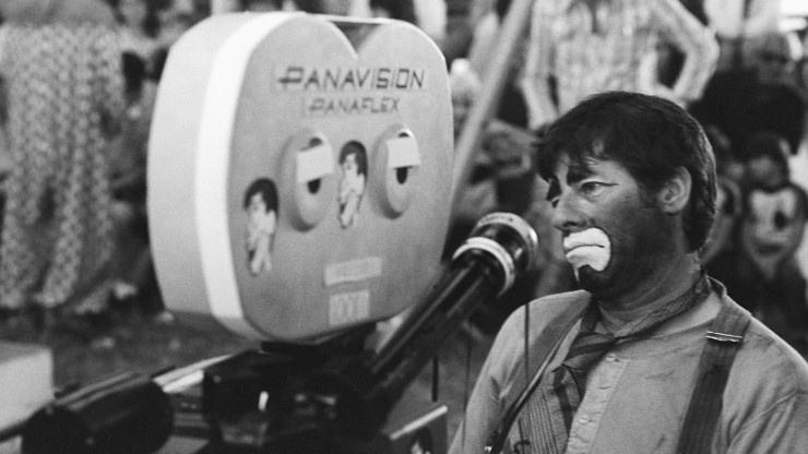 ca. 1978-1979, Pompano Beach, Florida, USA --- Jerry Lewis Sitting Next to Panavision Camera --- Image by © Owen Franken