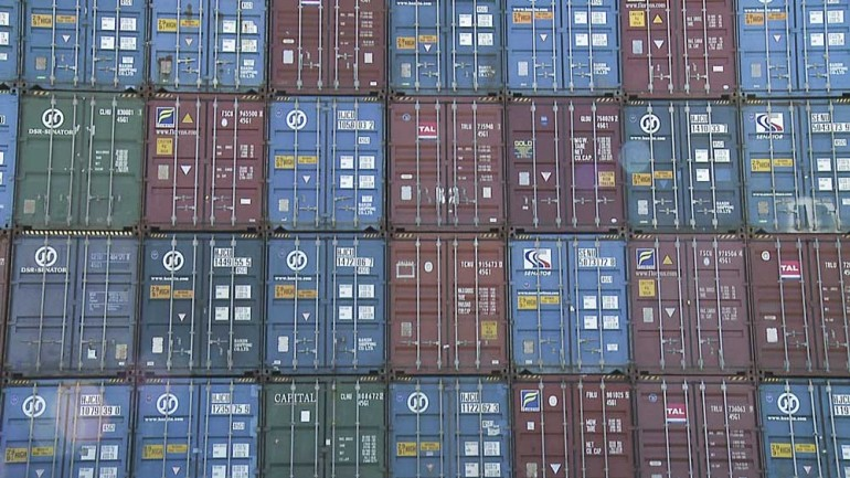 A quilt-like pattern of shipping containers stacked at the Port of Savannah.