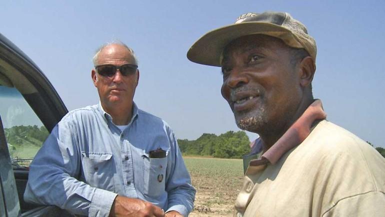 Cotton farmer Carl Brown and his farm hand, Grover Tyler.