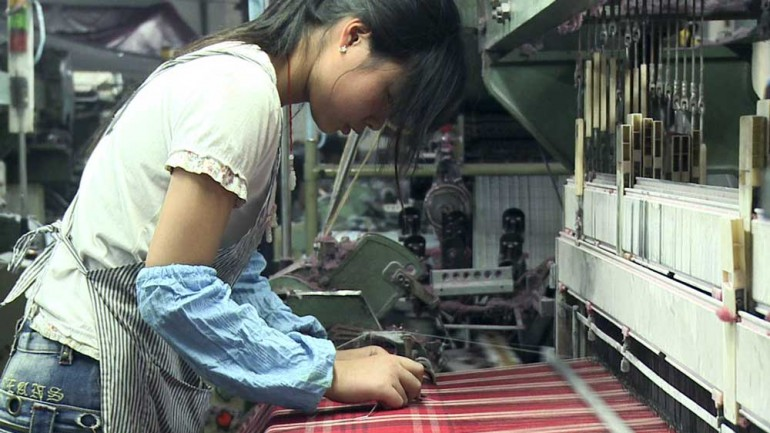 still photo of a textile worker from the film