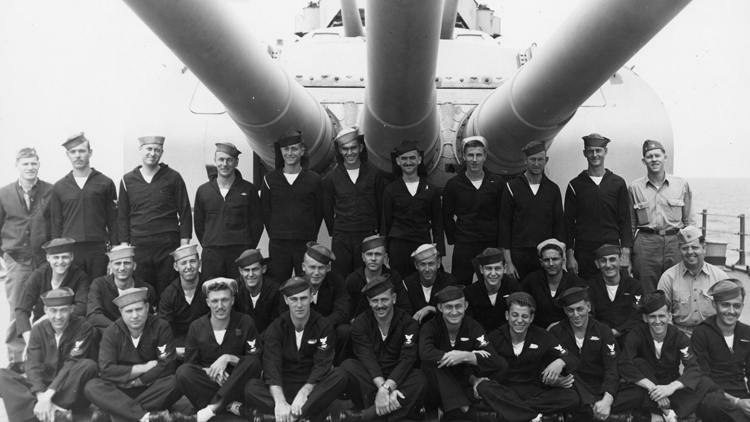 Navy men posing for a picture atop the USS Indianapolis. Photo courtesy of Alfred J. Sedivi Collection - USNI.